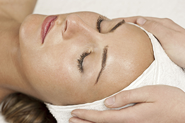 a woman relaxes during a spa treatment. facial.
